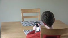 Boy Watching Device Stock Footage