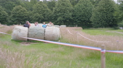 4K Competitors in assault course race, males helping females over obstacles Stock Footage