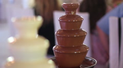 Fountain of milk and white chocolate Stock Footage