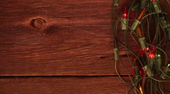 Flashing garland on the wooden floor. Stock Footage