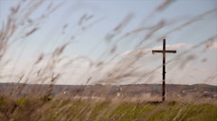 Crucifixion and windy grass Stock Footage