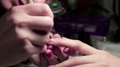 Applying gel nail polish Stock Footage