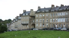 Houses and grazing sheep in the City of Bath Stock Footage
