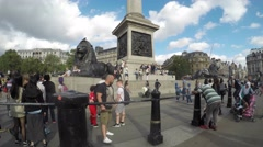 Tourists and lion statues in panning timelapse of Trafalgar Square Stock Footage