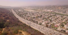 Pan around Los Angeles cityscape from the valley to downtown skyline. 4K UHD Stock Footage