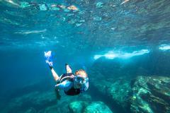 Apnea in tropical sea Stock Photos