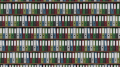 Big archive full of colored binders horizontal dolly shot. 4K seamless loop able Stock Footage