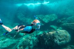 Snorkeling in coral reef Stock Photos