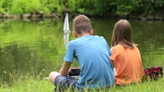 Children with remote controlled boat Stock Footage