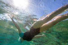 Woman sea snorkeling Stock Photos