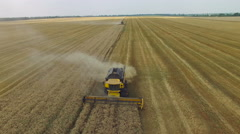 Combine harvester gathers the grain Stock Footage