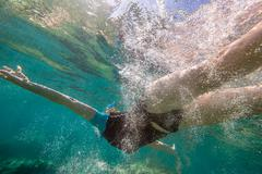Woman free diving - stock photo