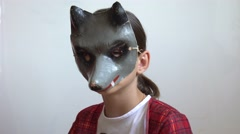 Girl in an antique theater mask plays the role of a wolf Stock Footage