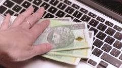 Money on keyboard of laptop Stock Footage