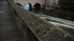Pulteney Bridge in the city of Bath on a good day - tilt Stock Footage