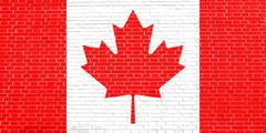 Flag of Canada on brick wall texture background Stock Photos