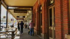 Australia Beechworth people walking by shops - stock footage