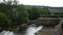 Pultney Bridge stone vase and the River Avon in the City of Bath Stock Footage