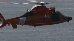 Coast Guard Helicopter Hovers and Lowers a Line - stock footage