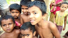 Village children in India smile and fool around in front of the camera Stock Footage
