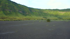 Backpacker male traveler walking around Bromo volcano valley in Indonesia Stock Footage