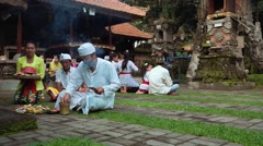 Balinese praying ceremony in an old temple Stock Footage
