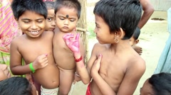 Village children in India smile and fool around in front of the camera, - stock footage