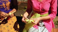 Women making balinese Canang sari offerings, close up Stock Footage