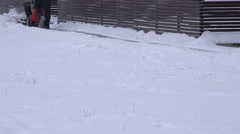 Man working with snow blowing machine on pavement after snow fall in winter. 4K Stock Footage