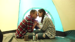 Young tourist couple have a sensual moment in tent at windy weather. Beautiful - stock footage