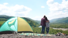 Young tourist couple have a sensual moment in camping. Beautiful young man Stock Footage