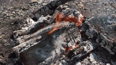 Flames of cozy campfire burnt to embers. Light flame burning on rocky ground Stock Footage