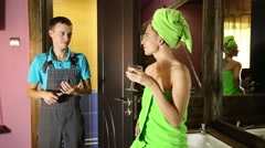 Plumber having flirt with young girl at home. men with young female customer - stock footage