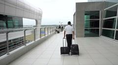 Kuala Lumpur, Malaysia - 29 June 2016; Flight attendant walk with luggage Stock Footage