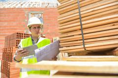 Foreman using digital tablet on construction site Stock Photos