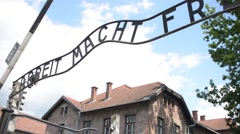 Auschwitz Concentration Camp Entrance - barracks and barbed wire Stock Footage