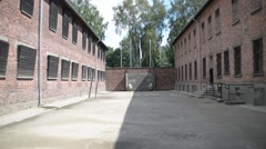 Auschwitz Concentration Camp - barracks and barbed wire Stock Footage