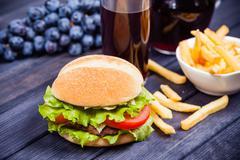Hamburger on the table, grape juice Stock Photos