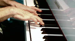 Musician on the piano keys. Stock Footage