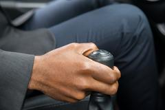 Close-up Of Person's Hand Changing Gear While Driving Car Stock Photos