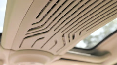 Car roof with windows and ribbed ventilation between 4K Stock Footage