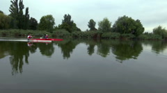 Young team members training in a kayak Stock Footage