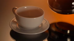 White cup of hot coffee or black tea on shiny background Stock Footage