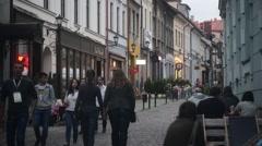 Bielsko Poland, modest cozy cafe on narrow street evening. Night life Europe Stock Footage