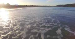 Aerial of whangamata beach at sunset, Coromandel, New Zealand Stock Footage