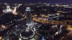 Night aerial flight over center of Moscow. House of music hall. Modern Glass. Stock Footage