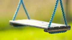Lonesome wooden swing in nature closeup 4K Stock Footage