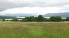 View to lake and farmland at connemara in ireland Stock Footage