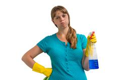 Tired housewife woman in yellow gloves with a rag and detergent on white back Stock Photos