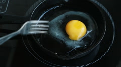 Frying eggs on a cast iron pan, Stock Footage